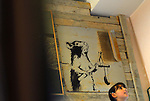 An artwork by British street artist Banksy, exhibited at the Santas Gallery in Bethlehem, West Bank.