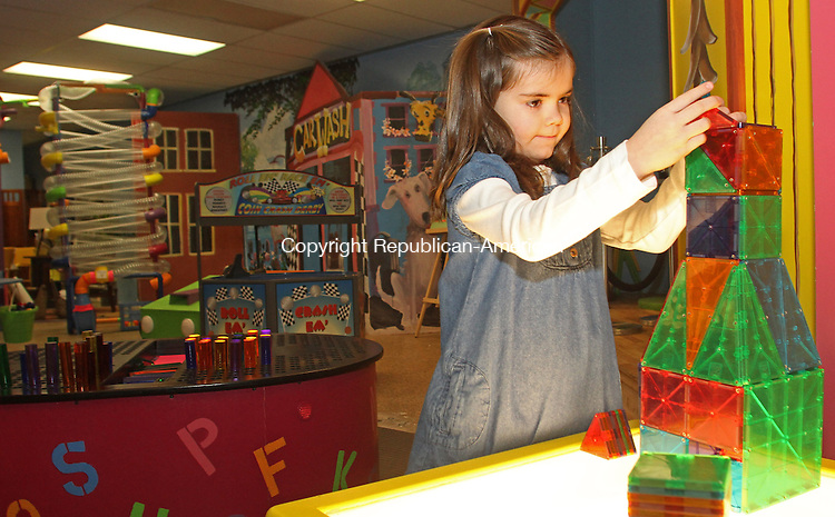 Torrington, CT-020213MK05 Isabelle Davis (6) builds a tower at a light table activity in the Children's Museum Preview on Main Street in Torrington on Saturday afternoon. Ken Merz, president of the Northwest Community Collaboration, said that the museum is looking to increase it's fund raising to expand the museum. Merz indicated that the museum's activities are helping to draw much needed foot traffic to the downtown area merchants. Michael Kabelka / Republican-American
