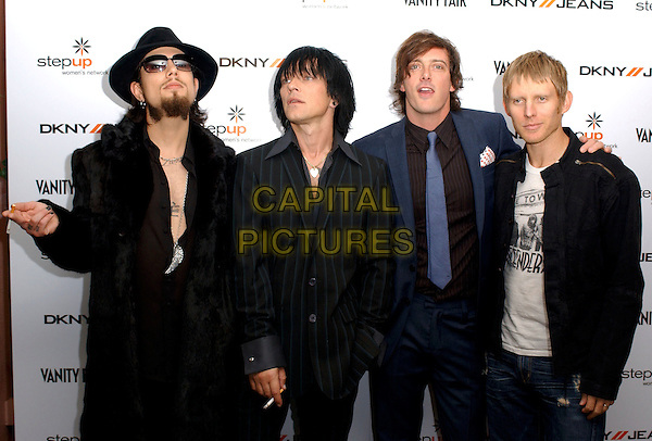 CAMP FREDDY.DAVE NAVARRO, BILLY MORRISON, DONOVAN LEITCH & CHRIS CHANEY.Backstage at the DKNY Jeans Vanity Fair Concert benefit for The Step Up Women's Network held at The Wiltern Theatre LG in Los Angeles, California, USA, .October 23rd 2004 .half length smoking cigarettes sunglasses tattoo tattoes hat  shirt undone chest.Ref: DVS.www.capitalpictures.com.sales@capitalpictures.com.©Debbie VanStory/Capital Pictures .