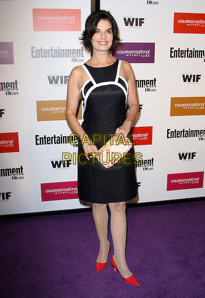 SELA WARD .2009 Entertainment Weekly & Women In Film pre-Emmy party held At The Sunset Marquis Hotel, West Hollywood, California, USA..September 17th, 2009.emmys full length black dress white trim red pointy shoes clutch bag .CAP/ADM/KB.©Kevan Brooks/AdMedia/Capital Pictures.