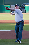 Nevada football coach Brian Polian throws out the first pitch before the Reno Aces against the Sacramento River Cats game on Friday night, April 12, 2013 in Reno, Nevada.