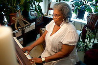 Burlyce Sherrell Logan (cq), a 73-year old woman who is graduating from the University of North Texas, plays the piano at home in Denton, Texas, Friday, May 6, 2011. Burlyce first attended the university in 1956, as part of.the group of African-Americans who were integrating it, but the atmosphere was so hostile she dropped out...Photo by Matt Nager