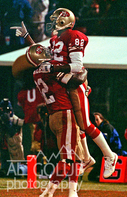 San Francisco 49ers vs. Philadelphia Eagles at Candlestick Park Monday, January 3, 1994.  Eagles Beat 49ers 37-34-OT.  San Francisco 49ers running back Ricky Watters (32) and wide receiver John Taylor (82) celebrate Taylor touchdown.