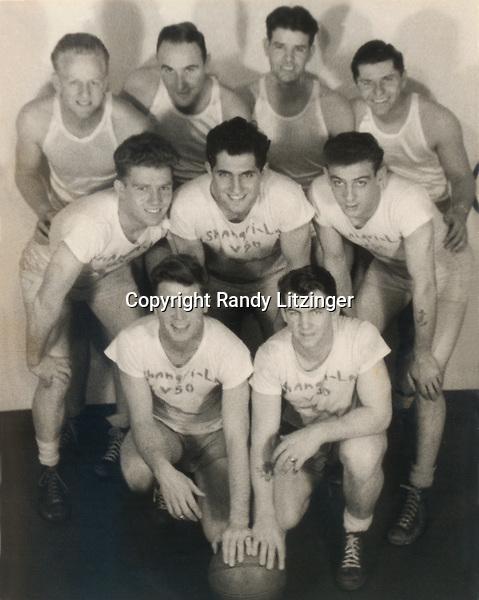U.S.S. Shangri-La V50 basketball team- <br /> front row: John 'Jack' Fogarty, James 'Tom' Thompson <br /> middle row: Homer 'Red' Ellis?, Henry J. Bartelloni, Harry Barnes<br /> back row: Al, 'Moose', May, Robert Hanna<br /> - 1944 or 1945  -- Photo By Wade Litzinger