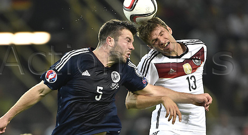 07.09.2014. Dortmund, Germany.   international match Germany Scotland  in Signal Iduna Park in Dortmund. Grant Hanley (SCO) challenges Thomas Muller (GER) for the header