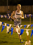Shane Helton (13) runs for the Nevada Men's Cross Country team as they compete for the first time in 25 years in the Bonanza Casino Nevada Twilight Classic season opener at Mira Loma Park in Reno on Friday night, August 30, 2019.