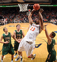 Nov. 12, 2010; Charlottesville, VA, USA;  Virginia Cavaliers forward Mike Scott (23) shoots in front of William & Mary Tribe forward Kyle Gaillard (23), William & Mary Tribe forward JohnMark Ludwick (33) and William & Mary Tribe guard Matt Rum (4) during the game at the John Paul Jones Arena. Virginia won 76-52.  Photo/Andrew Shurtleff