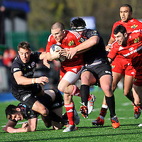 Hendon, England. Andrew Conway of Munster tackled  during the European Rugby Champions Cup match between Saracens and Munster at Allianz Park stadium on January 17, 2015 in Hendon, England.