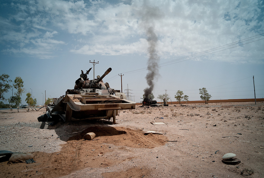 Gaddafi army tanks burn in Bir Ayad, Libya.