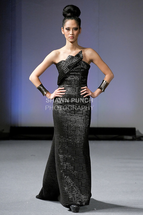 Elizabeth Thuytien walks runway in an outfit from the BlacMéra collection by Yuliana Candra, during Couture Fashion Week New York Fall 2012.