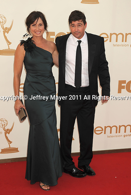LOS ANGELES, CA - SEPTEMBER 18: Kyle Chandler (R) and Kathryn Chandler arrive at the 63rd Primetime Emmy Awards at the Nokia Theatre L.A. Live on September 18, 2011 in Los Angeles, California.