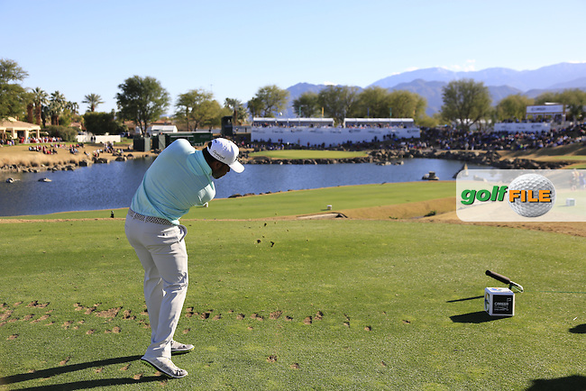 Harold Varner III (USA) tees off the par3 17th tee during Saturday's Round 3 of the 2017 CareerBuilder Challenge held at PGA West, La Quinta, Palm Springs, California, USA.<br /> 21st January 2017.<br /> Picture: Eoin Clarke | Golffile<br /> <br /> <br /> All photos usage must carry mandatory copyright credit (&copy; Golffile | Eoin Clarke)