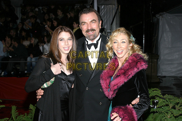 TOM SELLECK, HANNAH (DAUGHTER) & JILLIE (WIFE).31st Annual People's Choice Awards held at the Pasadena Civic Auditorium. .January 9th, 2004.Photo Credit: Jacqui Wong/AdMedia..half length, married, husband, father, tuxedo, pink fur trim.www.capitalpictures.com.sales@capitalpictures.com.© Capital Pictures.