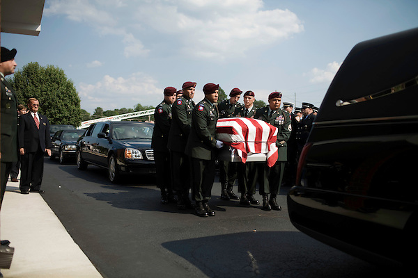 July 3, 2008. Washington, NC.. The funeral of Spc. Joel A. Taylor, assigned to the 1st Squadron, 3rd Armored Cavalry Regiment, Fort Hood, Texas; died June 25 in Mosul, Iraq, of wounds sustained when his vehicle encountered an improvised explosive device on June 24, 2008. He was 20.. The honor guard places Spc. Taylor's casket in the hearse for the ride to his family cemetery, about 14 miles from the funeral home.