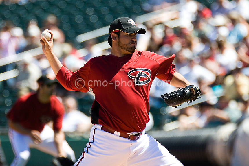 Mar 22, 2008; Tucson, AZ, USA; Arizona Diamondbacks pitcher Edgar Gonzalez (31) throws a pitch during a game against the Colorado Rockies at Tucson Electric Park.  The Rockies beat the Diamondbacks 12-11.