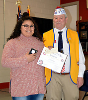 """Janelle Jessen/Herald-Leader<br /> Frank Lee, commander of Veterans of Foreign Wars Post 1674, right, presented Avah Duncan with the third place award and a $50 prize for the Patriots Pen essay contest, on Feb. 12. The subject of the essay was """"Why I Honor the American Flag."""""""