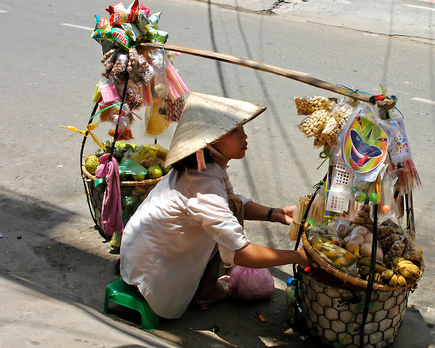 Woman selling on street in Saigon Vietnam
