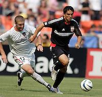 D.C. United's Jaime Moreno is chased by the MetroStars' Jeff Parke. D.C. United defeated the NY/NJ MetroStars 6 to 2 at RFK Stadium, Washington, D.C., on July 3, 2004.