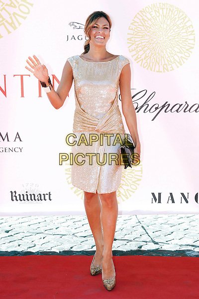 EVA MENDES.Arrivals at the Valentino Autumn/Winter 2008 Collection  held at the Villa Borghese in the Parco dei Daini, Rome, Italy, 7th July 2007..full length gold sequined shiny dress leopard print shoes black clutch bag bracelet bangle hand waving.CAP/OME.©Cesare Scaramuzzino/Omega/Capital Pictures.