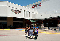 A group of people walk into the entrance to the Valley View Center Mall in Dallas, Texas, Saturday, August 21, 2010. ..MATT NAGER for the Wall Street Journal