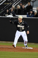 UCF Knights infielder James Vasquez (13) stretches for a throw during the opening game of the season against the Siena Saints on February 13, 2015 at Jay Bergman Field in Orlando, Florida.  UCF defeated Siena 4-1.  (Mike Janes/Four Seam Images)