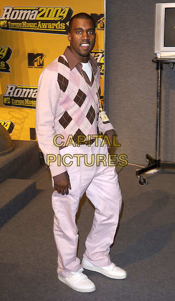 KANYE WEST.MTV Europe Music Awards,.Tor Di Valle, Rome, Italy, November 18th 2004..full length pink pringle style chequered jumper golfer.Ref:DH.www.capitalpictures.com.sales@capitalpictures.com.©David Hitchens/Capital Pictures.