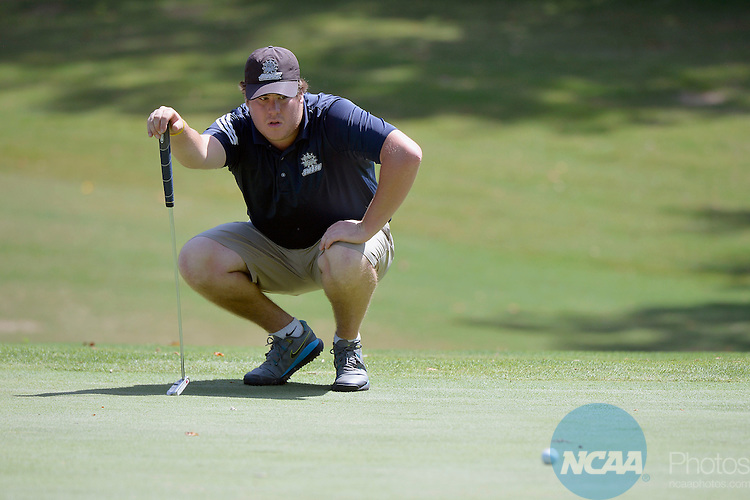 20 MAY 2015:  Jake Duvall of Southwest Oklahoma State lines up a putt on the 12th green during the Division II Men's Individual Golf Championship held at the Rock Barn Golf & Spa in Conover, NC. Grant Halverson/NCAA Photos