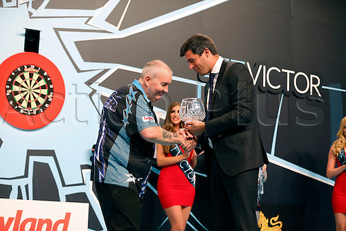 24.07.2016. Empress Ballroom, Blackpool, England. BetVictor World Matchplay Darts. Phil Taylor receives his runner-up trophy