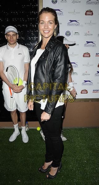 Gemma Atkinson<br /> attended the Slazenger Wimbledon Party, Whisky Mist bar &amp; nightclub, Hertford St., London, England, UK, 27th June 2013.<br /> full length black leather jacket jeans  white top trousers peep toe shoes studded side <br /> CAP/CAN<br /> &copy;Can Nguyen/Capital Pictures