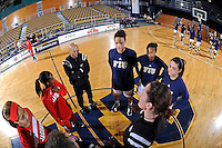 25 February 2012:  FIU's captains (from left to right, guard-forward Finda Mansare (23), guard Jerica Coley (22), and guard Carmen Miloglav (24)) meet with officials and South Alabama's captains prior to the game.  The FIU Golden Panthers defeated the University of South Alabama Jaguars, 58-55 (OT), at the U.S. Century Bank Arena in Miami, Florida.
