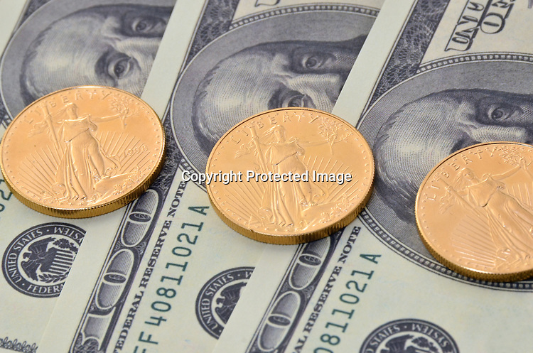 Stock of American Eagle gold coins and US Currency