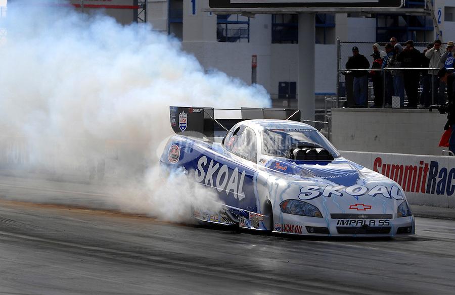 Jan 21, 2007; Las Vegas, NV, USA; NHRA Funny Car driver Tommy Johnson Jr does a burnout during preseason testing at The Strip at Las Vegas Motor Speedway in Las Vegas, NV. Mandatory Credit: Mark J. Rebilas