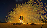 Fire spinning on the beach in Port Stephens in Australia