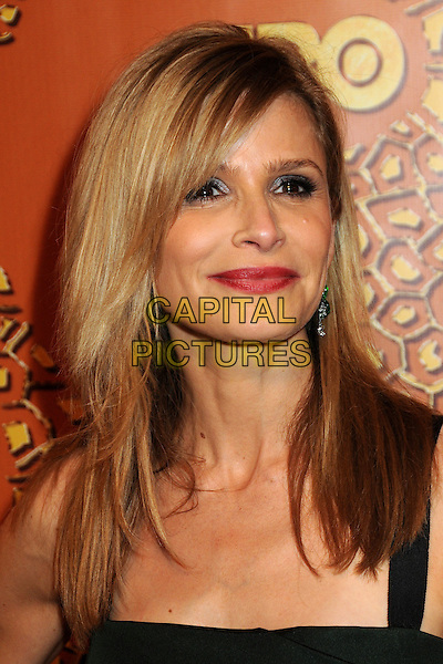 KYRA SEDGWICK.HBO's 2010 67th Golden Globe Awards Post Party held at the Beverly Hilton Hotel, Beverly Hills, California, USA..January 17th, 2009.globes headshot portrait green.CAP/ADM/BP.©Byron Purvis/Admedia/Capital Pictures