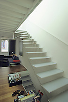 The cantilevered staircase emphasises the open plan design of the living area