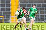 Philip O'Connor St Kierans and Rathmore Brendan O'Keeffe in action at the SFC clash in Fitzgerald Stadium on Sunday