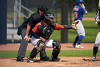 Umpire Chad Westlake and GCL Astros catcher Nerio Rodriguez (58) during a Gulf Coast League game against the GCL Mets on August 10, 2019 at FITTEAM Ballpark of the Palm Beaches Training Complex in Palm Beach, Florida.  GCL Astros defeated the GCL Mets 8-6.  (Mike Janes/Four Seam Images)