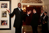 Professional basketball player Jason Collins, left, arrives to a state dinner hosted by U.S. President Barack Obama and U.S. First Lady Michelle Obama in honor of French President Francois Hollande at the White House in Washington, D.C., U.S., on Tuesday, Feb. 11, 2014. Obama and Hollande said the U.S. and France are embarking on a new, elevated level of cooperation as they confront global security threats in Syria and Iran, deal with climate change and expand economic cooperation. <br /> Credit: Andrew Harrer / Pool via CNP