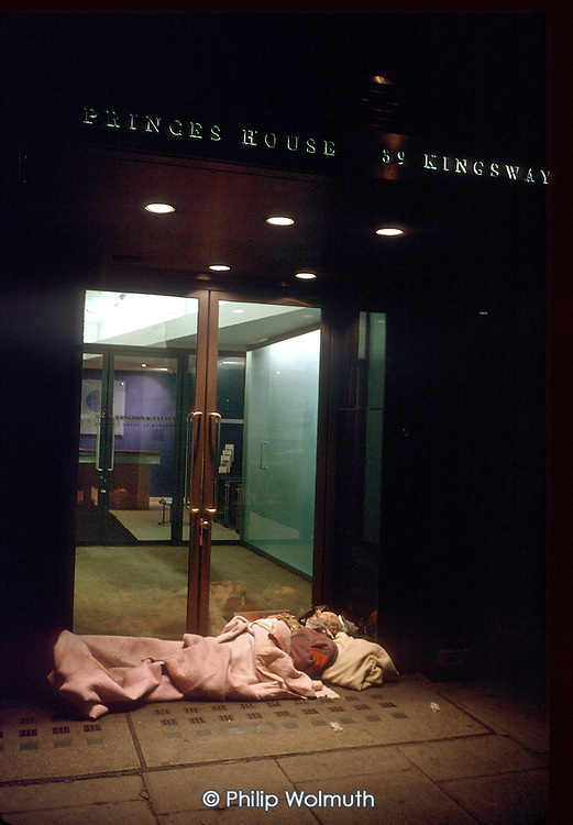 Elderly man sleeping a the doorway of a bank in central London