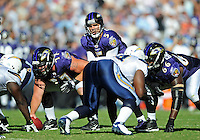 Sep. 20, 2009; San Diego, CA, USA; Baltimore Ravens quarterback (5) Joe Flacco prepares to take the snap from center (77) Matt Birk against the San Diego Chargers at Qualcomm Stadium in San Diego. Baltimore defeated San Diego 31-26. Mandatory Credit: Mark J. Rebilas-