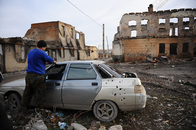 A damaged car was being repaired in the Jewish quarter of Tskhinval, the South Ossetian capital, which was badly damaged in the first war with Georgia in the 1990's and again in the war in August 2009. February 12, 2009