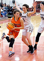 Westside Eagle Observer/RANDY MOLL<br /> Gravette senior Gabbi Scott goes around Gentry seniors Ahrya Reding and Heidi Vinson and gets set to shoot from the right side of the basket during play in Gentry on Feb. 4, 2020.