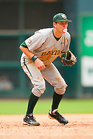 Third baseman Jake Miller #20 of the Baylor Bears blows a bubble while playing defense against the Houston Cougars at Minute Maid Park on March 4, 2011 in Houston, Texas.  Photo by Brian Westerholt / Four Seam Images