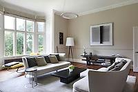Antonio Citterio sofas, Idris Khan artworkand Swarovski chandelier in the sitting room