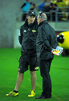 Hurricanes s&c coach Dave Wildash talks to team manager Tony Ward during the Super Rugby match between the Hurricanes and Reds at Westpac Stadium, Wellington, New Zealand on Saturday, 14 May 2016. Photo: Dave Lintott / lintottphoto.co.nz
