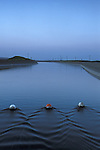 Evening light over flowing water in the California Aqueduct, near Patterson, California