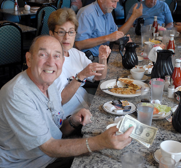 "Former Newsday photographer, Cliff DeBear and former Newsday Photo Dept. secretary, Sandy Gerry among the attendees at the monthly ""Dinosaurs Brunch"" of retired journalists gathered at the Spartan Diner in Farmingdale on friday July 14, 2006. (Copyright2006/Jim Peppler)"