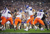 Jan. 4, 2010; Glendale, AZ, USA; Boise State Broncos quarterback (11) Kellen Moore hands the ball off in the third quarter against the TCU Horned Frogs in the 2010 Fiesta Bowl at University of Phoenix Stadium. Boise State defeated TCU 17-10. Mandatory Credit: Mark J. Rebilas-.