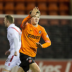 Blair Spittal fires in a free-kick to score for Dundee Utd and celebrates his goal