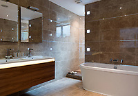 BNPS.co.uk (01202 558833)<br /> Pic: MrAndMrsClarke/BNPS<br /> <br /> Bathroom <br /> <br /> A luxury house on an English country estate where the Allies plotted the infamous assassination of one of Adolf Hitler's top henchmen has gone on the market.<br /> <br /> Rooftops, a Norwegian-style chalet, is located on the Moreton Paddox estate in Warwickshire where 4,000 Czech soldiers were billeted during the Second World War.<br /> <br /> The plot to assasinate Nazi monster SS General Reinhard Heydrich involved two Czech soldiers who parachuted into Prague where they attacked and killed him as he was driven to work. <br /> <br /> His death led to appalling Nazi reprisals on locals, with more than 1,300 men, women and children massacred.<br /> <br /> The Edwardian mansion at Moreton Paddox that was requisitioned for the war effort was later demolished and Rooftops was built on the grounds in 2009.